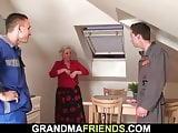 Busty old grandma spreads legs for two repairmen