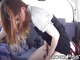 Japanese gal distracts friend and pees next to her in car